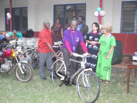 Bishop Mwita on a test ride of donated bicycle