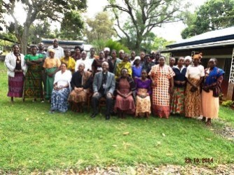 2- Bishop Mwita with women farmers after training