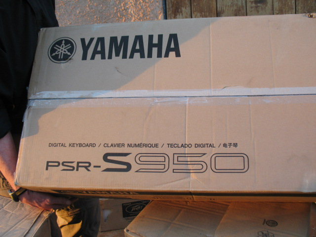 A box containing Yamaha Keyboard