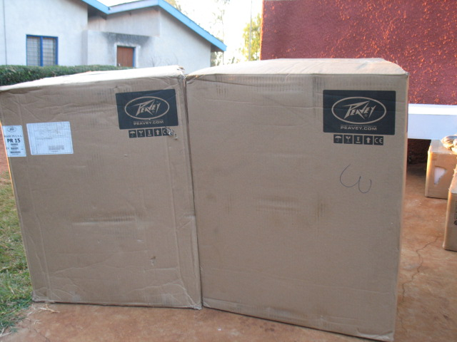 Boxes containing Peavey Speakers