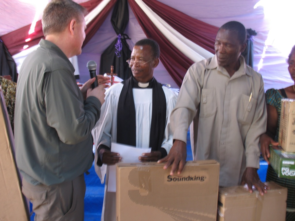Canon Bwiru of Mogabiri and some vestry members receiving the instruments