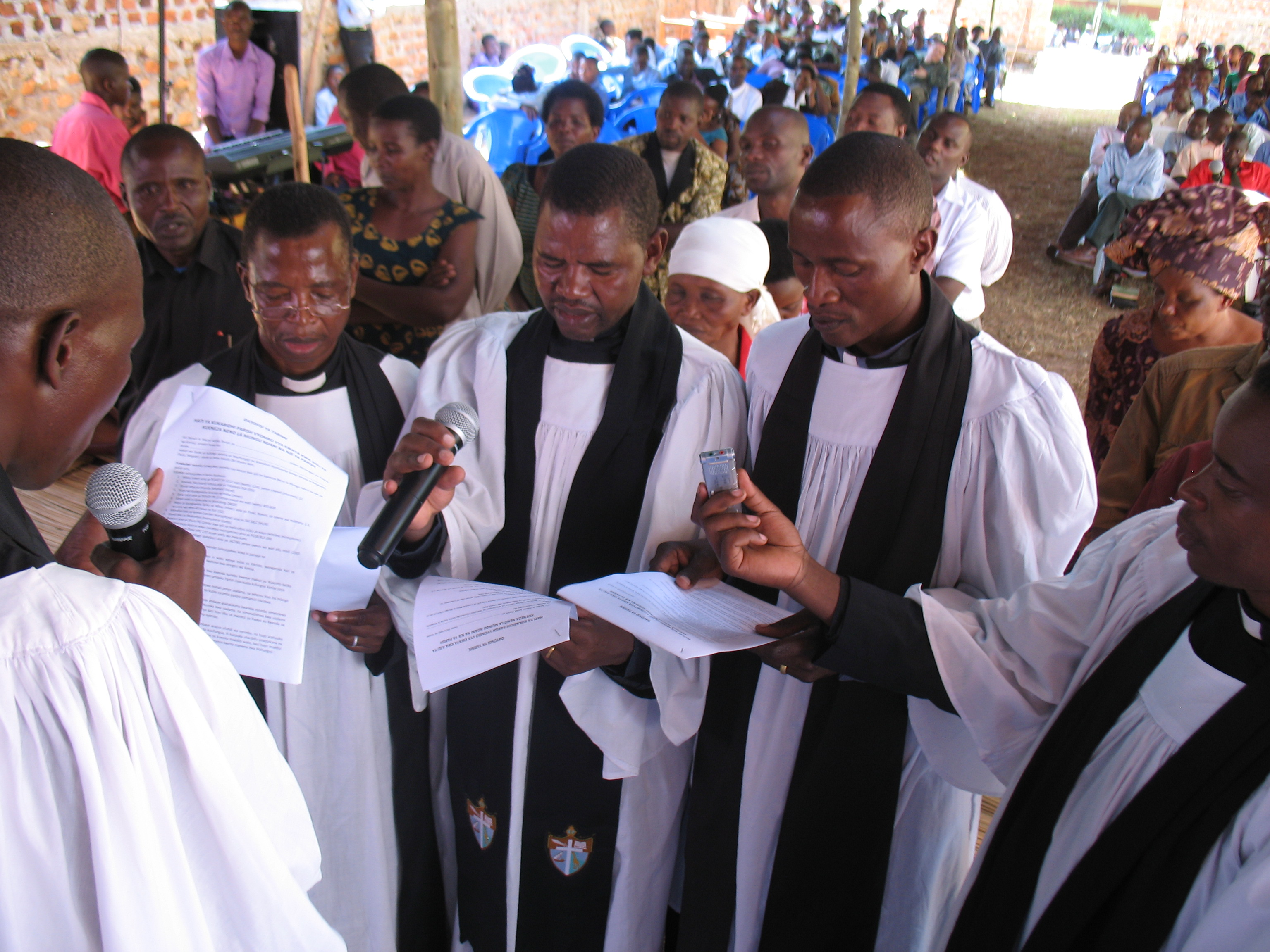 The three priests Fred, Yohana and Charles making a pledge to take care of the instruments