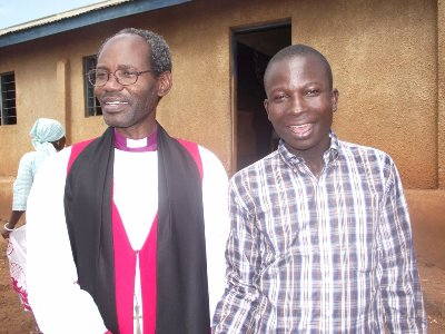 Bishop Mwita with a young member of Nkongore congregation on 8 May 2011