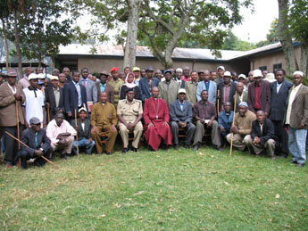 Bishop Mwita in a group photo with Community-Clan Leaders in Tarime  after the meeting at Mogabiri Agricultural Centre on 23 July 2012.
