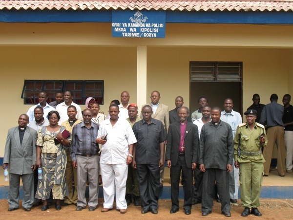 A group photo outside the Regional Police Commander's office in Tarime.
