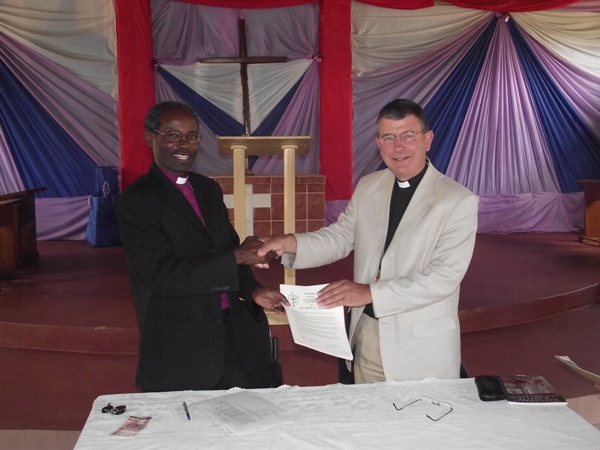 A hand of friendship after signing of the covenant between Wakefield and Tarime dioceses