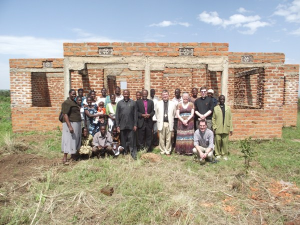 A photo in front of the Kemnage pastor's house under construction