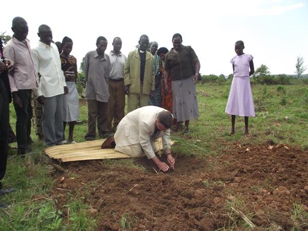 Bishop Stephen planting a tree at Kemnage parish church