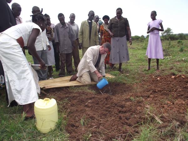 Bishop Stephen watering a tree at Kemange parish church