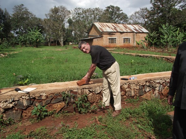 Bishop Stephen laying a brick at the new church to be built at St Paul's Church at Mogabiri.