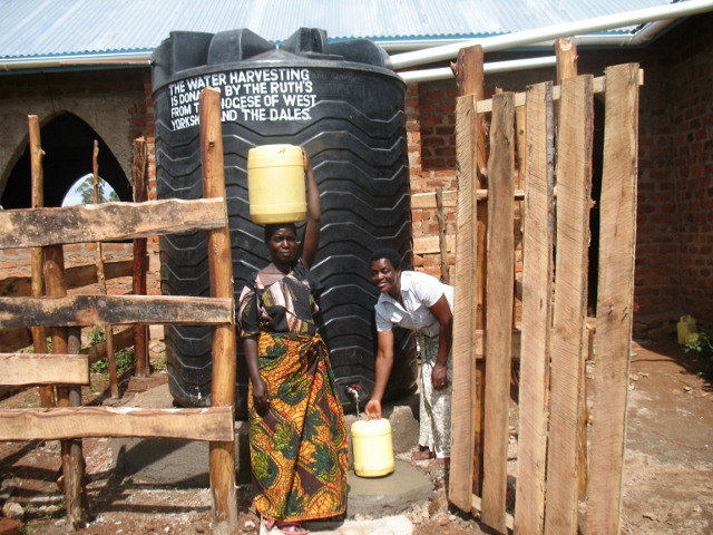 Women from the community collecting water at Bugumbe Church