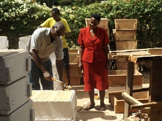 11-a trained farmer making beehives for other beekeepers