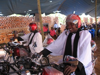 Priests on motorcycles after dedication in church